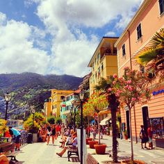 Monterosso, Cinque Terre, Italy. We stayed right in that teal building on the beach. :)