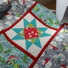 Christmas tree skirt with lots of odd twists and turns makes mitered corners challenging. But very worthy! Mountain Quiltworks