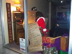 Santa's desk with a list of items the Fox River Wood Shop makes, featuring his wooden ornaments on the tree and unwrapped handmade jewelry boxes!