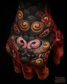 Woooooow! Hand piece by Yushi. #inked #inkedmag #tattoo #hand #color #colorful #Yushi #dragon
