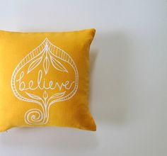 Pillow Cover - Cushion Cover - Believe in White on Mustard Yellow Linen - 12 x 12  inches. $22.00, via Etsy.