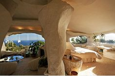 """A contemporary interpretation of prehistoric life is found in the late Dick Clark's """"Flintstone"""" residence.  Built in the Malibu Hills, this home consists of one bedroom and two bathrooms, and is designed with irregular shapes and stone colors."""
