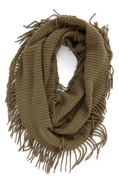 Textured with a cozy ribbed knit, this lightweight scarf features playful fringe trim and is designed to wrap jauntily around the neck for the perfect finishing touch to the fall outfit.