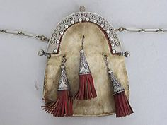 Perhaps an 18th Century cantle, now silver plated with a later (perhaps 1920s) bag