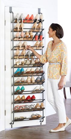 "Make the most of underutilized space behind the door for your shoe collection. Our 36-Pair Overdoor Shoe Rack holds both heels and flats. Can you say, ""solemate?"""