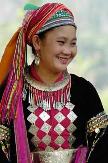"""Karen people - Thailand  The website captions this picture as the """"Thai Karen Lady.""""  It explains the difference in tribes and the languages that are within each tribe of the Karen culture. It is important for a nurse to get the correct context if one were to need a translator."""