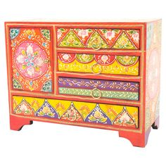 A bohemian addition to your living room or conservatory, this hand-painted wooden chest features four drawers and a closed cupboard.   ...