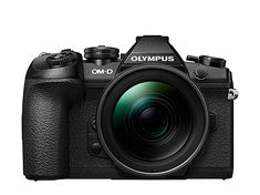 The Olympus OM-D Mark II is the flagship Micro Four Thirds camera of the Japanese manufacturer. The New flagship of Olympus has been recently released. It's the OM-D MARK Cameras Nikon, Camera Lens, Video Camera, Pancake Lens, Sony, Centenario, Camera Settings, Black Body, Mount Olympus