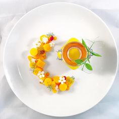 Over head shot of...Roasted Peach/carrot & cinnamon velouté with turned carrots & peach glazed in a carrot & peach reduction with carrot gel  Caribbeanculinarycollective #topcaribbeanchef #barbados #chefsroll #chefsofinstagram #chefstalk #gastropost #gastronogram #gastroart #theartofplating #chef #chefs #Beautifulcuisines #peach #carrot #velouté #bajanchef #bajans