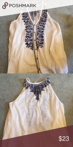 super cute flowy tank w blue detail Great with jeans. Flattering neck line. Button up v neck. Could be a tunic longer to medium cut Tops Tank Tops