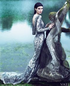 even though this is fashion..the staue and water with her dress is pure art to me!!!