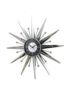 Sleek and stylish, the George Nelson Silver Sunburst Wall Clock adds modern inspiration to any wall. This clock features a combination of starburst. Sunburst Clock, Tabletop Clocks, Metal Picture Frames, Clock Decor, Wall Clocks, Wall Decor, Wall Art, George Nelson, Dcor Design