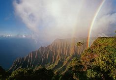 Kalalau Lookout, Kauai - The first time, all I saw was clouds.  The second trip I saw seven rainbows in an hour, some of them simultaneously.  It is where heaven, the ocean, the earth and you can intersect.  Goosebumps and happy tears.  You are changed forever.