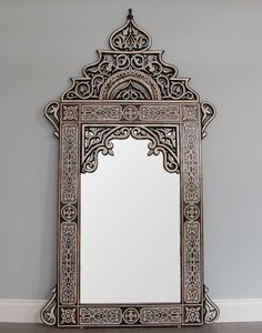 Moroccan Mirror. Would love this hung as a full length mirror if it were big enough.