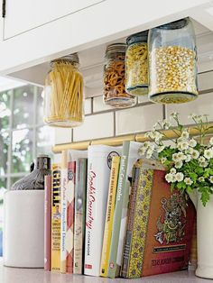 There are yet-to-be-discovered storage spots lurking in even the teeny-tiniest of kitchens—under the shelves, behind cabinet doors, right on the wall