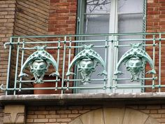 Le Castel Béranger, 14 rue la Fontaine - Paris, France XVI. Guimard's masterpiece of 1895-98 epitomises art nouveau in Paris. The faces on the balconies are thought to be self-portraits, inspired by Japanese figures, to ward off evil spirits.  A must see.