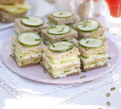 Cucumber & herb triple-deckers. Traditional cucumber sandwiches on brown bread are given a facelift with mint and chive cream cheese.
