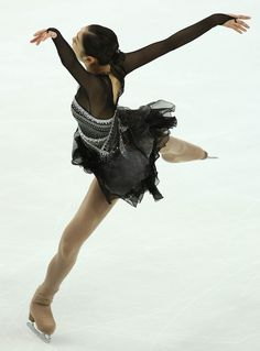 Yuna Kim: The closest thing to ballet on ice. Lovely, lovely lines and such a fragile, balletic body.