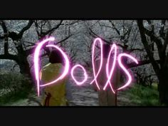 Dolls, Takeshi Kitano -- Bound by a long red red cord, a young couple wanders in search of something they have tragically lost. An aging yakuza boss mysteriously returns to the park where he once met his long-past girlfriend. A disfigured pop star confronts the phenomenal devotion of her biggest fan.
