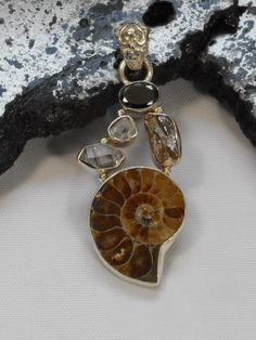Artisan handmade Ammonite Fossil pendant, suitable for men or women, accented with 1 double-terminated Herkimer Diamond, one round Herkimer Diamond, one oval faceted Black Onys gemstone, and 1 Campo d