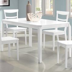 Showcasing a clean-lined design and crisp white finish, this wood dining table is perfect topped with bright dinnerware for eye-catching style. ...