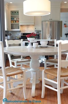 kitchen set makeover - Painted pedestal table and chairs, table top was stained with Rust-Oleum Driftwood Corinne Madias Realtor Metro Detroit Michigan http://www.remodelandolacasa.com/2014/10/Mw4h.html