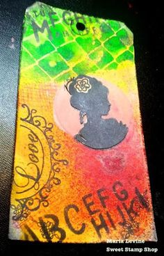Mixed Media tag using Stamps from Sweet Stamp Shop, Crafter's Workshop stencils and dylusions sprays.