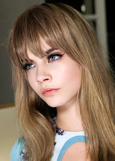 Retro bangs at Pucci  Be as darling as a doll with this vintage-inspired look. Wear your bangs long (skimming your heavily lined eyes) and add face-framing layers at the front. Psychedelic-print dress not included...but definitely recommended!