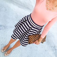 Striped skirt, blush long sleeve tee, leopard foldover clutch, gold and pink watch, statement necklace for work