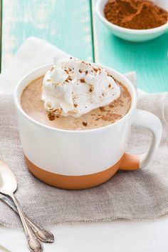 Pumpkin spice gives this dreamy mug a distinctly fall flavor. Combine 1/2 cup coffee, 1/4 cup hot milk and 1/4 cup International Delight Vanilla Macchiato Creamer, then stir in 1/4 tsp pumpkin spice. Top with whipped cream, cocoa powder and white chocolate curls for a decadent treat sure to perk up your mug.