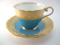 Reserve for Amy Antique 1930's Aynsley Tea Cup And Saucer , English tea set, bone china, Turquoise and gold leaves on  Yellow Cream  .