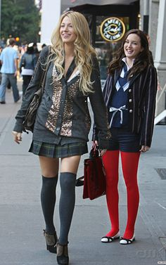 I dig how they use colored tights in a lot of Blair's wardrobe.  This outfit is great.  I love the red tights and the striped jacket.