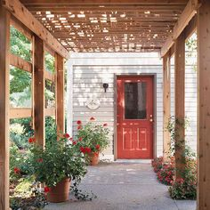Pergola Entryway - Love the red door and the completmentary red roses and impatiens!  Really pops!