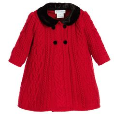 Baby girls luxurious red pram coat byRalph Lauren, made in a soft cable knitted wool. This wonderfully warm and cosycoat is in a double breasted style, with black buttons and collar, made in a silk velvet blend. It has a finely knitted, cotton lining for extra warmth and comfort.