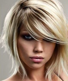 Deep parted, side swept bangs. I love this style!