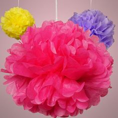 Great party decor - colorful tissue paper pom poms. #tissuepaperpompom #pompoms #tissuepaper