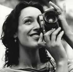 Birthday edition: today's über-cool celebrity with an über-cool Leica camera is a maniac on the floor: JENNIFER BEALS! Jennifer Beals, Antique Cameras, Vintage Cameras, Leica Camera, Rangefinder Camera, Girls With Cameras, The L Word, Celebrity Photographers, Celebrity Photos