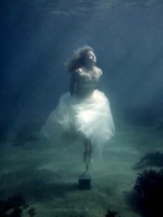 Under Water Photography  I like the soft colors of the water and the person. I like that there is a story in the photo.