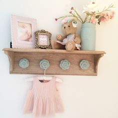 A mint, pink and gold nursery. It is shabby chic, vintage, elegant and ultra feminine. To me, it is a nursery fit for the girliest of girls.