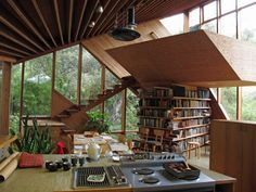 Look at this beautiful mid-century wooden house designed by American architect John Lautner! Surrounded by forests, this asymmetrical architectural beauty was built in 1969 on a hill in the Santa Monica mountains just outside of Los Angeles.