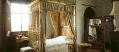 Penrhyn Castle: The brass bed which was ordered for the Prince of Wales when he stayed at Penrhyn