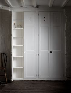 The Classic Fitted Pantry by deVOL - These pantry doors, with fully fitted interiors have made a small, shallow, quite unassuming alcove on the ground floor of the Mill into a well organised, neat, row of cupboards. Simple and functional, fitted with shelves and hanging space it shows you how to make the very most of these places and spaces within your home.