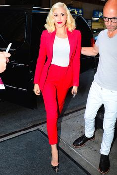 Who: Gwen Stefani  What: Seeing Red Why: The singer-TV host-designer is doing the rounds in NYC and looking like a star in a red pantsuit by Altuzarra, accessorized with Meira T rings. With that kind of tailoring and color you don't need a record contract to stand out in a crowd—and for the less bold, a statement jacket will do the trick.  Get the look now: Stella McCartney jacket, $1,295, net-a-porter.com. Splash News  - HarpersBAZAAR.com