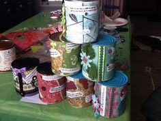 Thank you Tracy Nolan for applying your master talent to these fabulous time capsules. For followers: I emptied 28 oz. cans using the Pampered Chef can opener on the bottom. Washed, dried and farmed them out for decorating. Guest wrote notes to each other to read next New Years day.  Notes, memorabilia and candy were sealed into the cans by glueing bottom back on. Guest will use can openers to open the tops so they can read their messages and enjoy gifts.