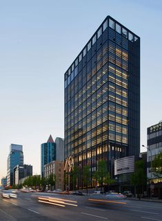 """""""A new icon in the heart of Gangnam-gu, one of Seoul?s largest districts, this 15-story building unites more than 500 Shinsegae employees who were previously..."""