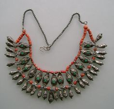 A necklace from the Zanskar Valley in the western Himalayas, near to Ladakh. This kind of necklace was worn by women. Material silver, coral and turquoise, first half of the 20th century. Posted by Michael Beste.