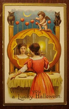 Looks like this lady is trying some divination in the mirror!  On Samhain there are many divinations that require looking into mirrors for reflections - perhaps she is hoping to see the reflection of her true love appear!