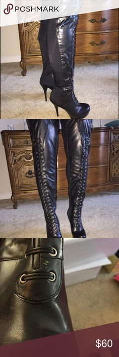Thigh High Boots 5 inch heel. Has laces but you don't have to tie them - if that makes any sense. The back of the boot is a a spandex type of material. Zipper on the side. The sole has a combat boot grip. Very sexy & comfortable. Worn once.  Scratch on front of right boot - included in pic. Shoes Over the Knee Boots