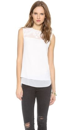 Tonal embroidery brings romance to a Cooper & Ella top. Gold-tone buttons close over the back slit. Banded edges. Sleeveless. Semi-sheer.  F...