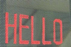 Hello stitched on Screen Door